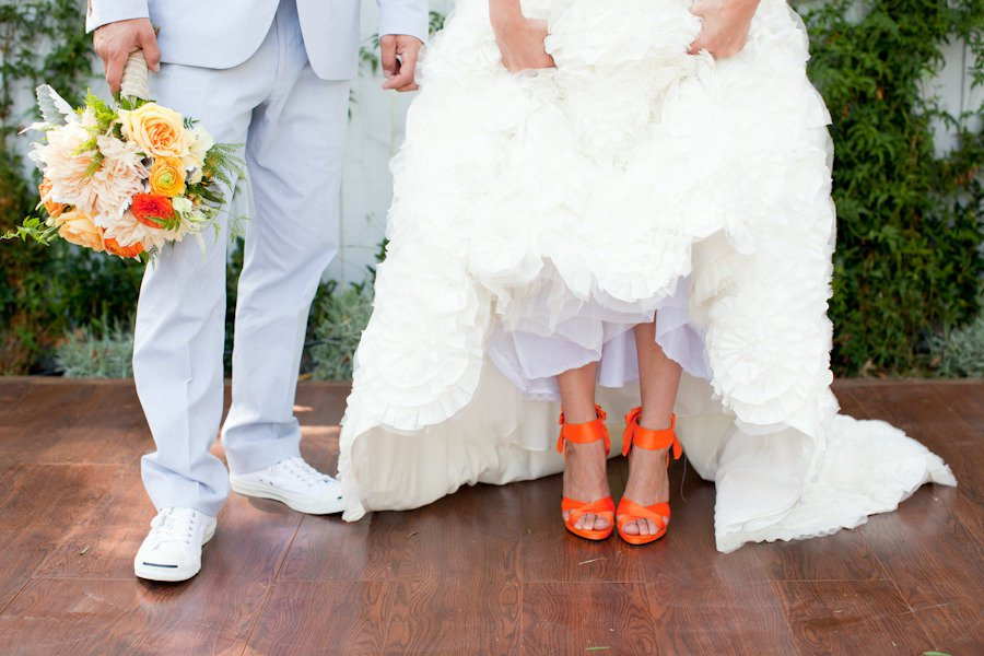 bride-wears-white-wedding-dress-hot-orange-heels